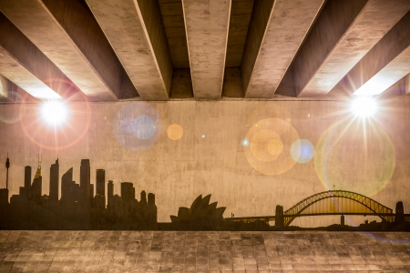 indy: Sydney skyline as wall drawing on the support column of an overpass