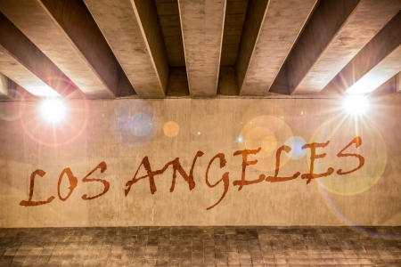 The word  Los Angeles painted as graffiti on the support column of an overpass photo