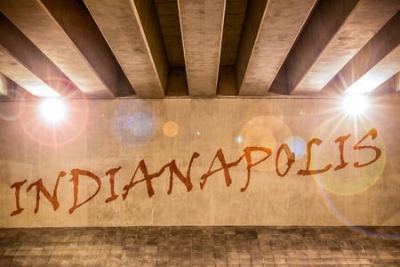 indianapolis: The word Indianapolis painted as graffiti on the support column of an overpass Stock Photo