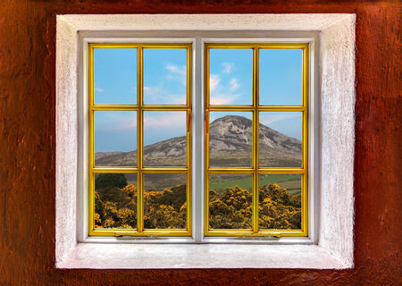 View of a mountains seen through a window photo