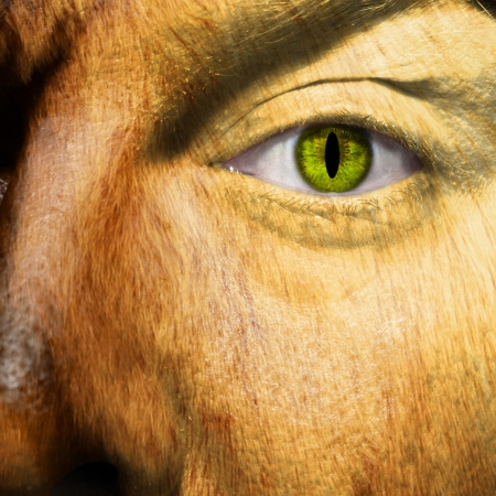 slit: A man changing into a werewolf with slit pupil Stock Photo