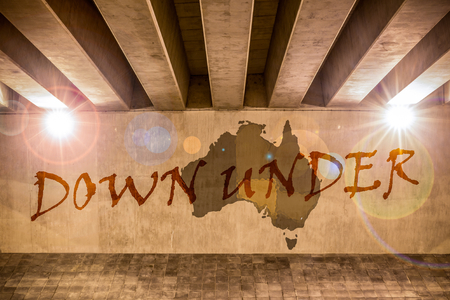 down under: Down under map as wall drawing on the support column of an overpass Stock Photo