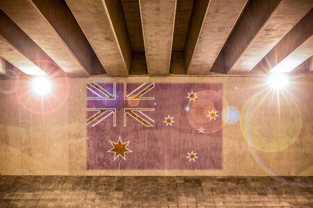 Australian flag painted on a wall of an overpass
