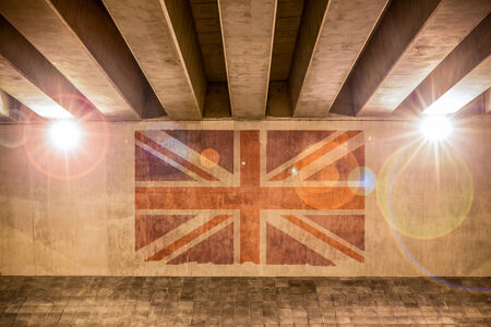 Union Jack flag painted on a wall of an overpass
