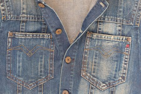 stone wash: DUBLIN, IRELAND - 26 JANUARY, 2014  Close up of a Replay denim jacket with copper buttons