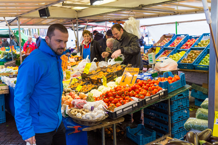 street market: ZWOLLE, THE NETHERLANDS - FEBRUARY 1, 2014: Unidentified people buying groceries at the street market in Zwolle Editorial