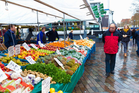 gaff: ZWOLLE, THE NETHERLANDS - FEBRUARY 1, 2014: Unidentified man visiting the street market in Zwolle