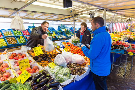 ZWOLLE, THE NETHERLANDS - FEBRUARY 1, 2014: Unidentified people buying groceries at the street market in Zwolle Editorial