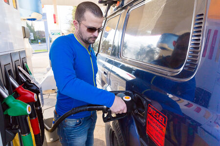 land shell: ZWOLLE, THE NETHERLANDS - FEBRUARY 3, 2014: Unidentified man filling up a Toyota Land Cruiser with diesel at a Shell gas station. Shell have 44,000 service stations worldwide. Editorial