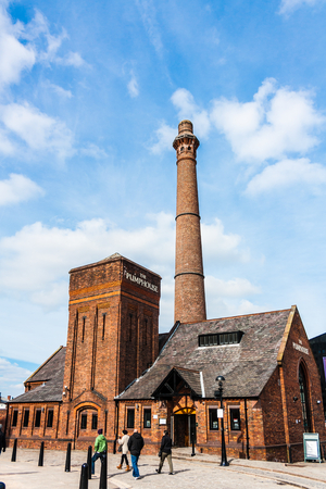 LIVERPOOL, ENGLAND - MARCH 31, 2014: The Dock�s former pumphouse was built in 1870 and has been restored as a traditional British pub serving British food.