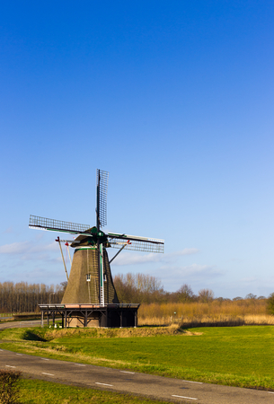 smock: The Windesheimer smock mill seen on a sunny winter day in February was built in 1749 in The Netherlands