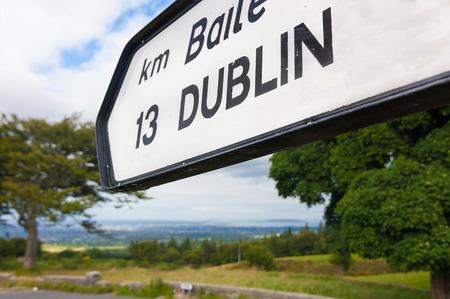kilometres: Directional road sign indicating Dublin 13 kilometres Stock Photo