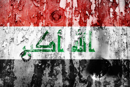 iraq flag: Iraq flag on a weathered grunge background Stock Photo
