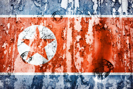 defaced: North Korea flag on a weathered grunge background
