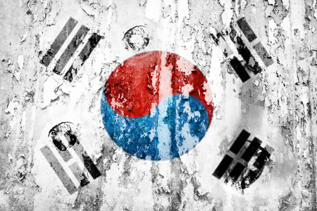 defaced: South Korea flag on a weathered grunge background