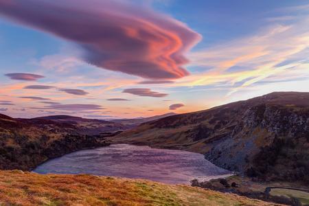 tay: Colourful sunset over Lough Tay in Wicklow Stock Photo