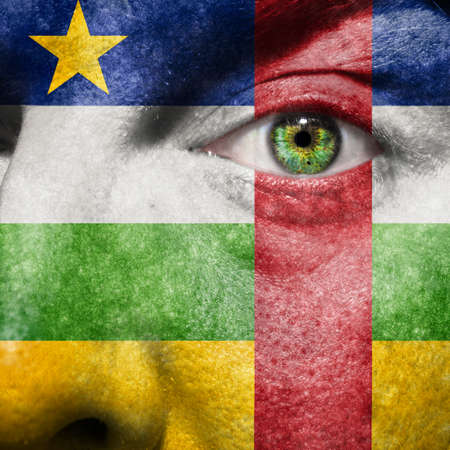 Central African flag painted on a man Stock Photo - 27087264