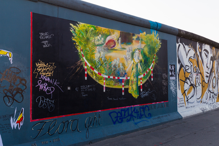 mauer: BERLIN - MARCH 30, 2014  East Side Gallery in Berlin contains artwork and graffiti and is an international memorial for freedom  The wall is 1 3km long