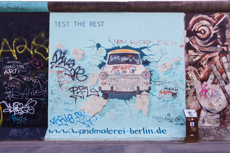 BERLIN - MARCH 30, 2014  East Side Gallery in Berlin contains artwork and graffiti and is an international memorial for freedom  The wall is 1 3km long
