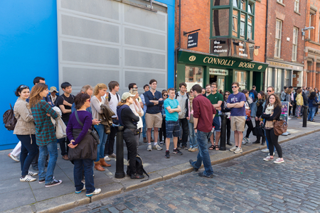 DUBLIN - MAY 17, 2014: Group of tourists on a guided tour in Temple Bar. Temple Bar in Dublin city is a popular tourist destination.