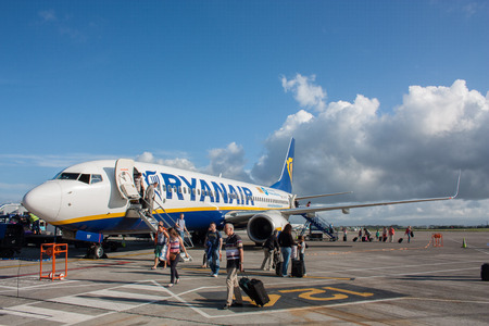 EINDHOVEN, THE NETHERLANDS - AUGUST 4, 2013  People debarking a Ryanair Boeing 737-800