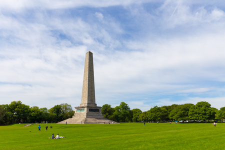 wellesley: DUBLIN, IRELAND - MAY 17, 2014: The Wellington Monument is an obelisk located in the Phoenix Park. The monument is 62 metres (203 ft) tall and it is the largest obelisk in Europe.