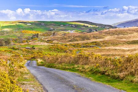 lough: Land road leading to Garraunbaun Lough in Connacht Stock Photo