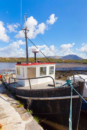 weather beaten: Moored fishing boat in Letterfrack Stock Photo