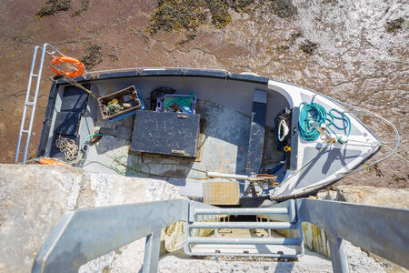 weather beaten: Moored rowboat seen from above