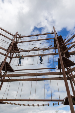 combined effort: Mother and son fearless on an obstacle course