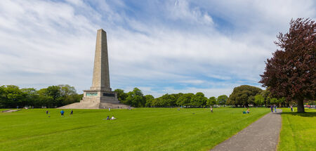 DUBLIN, IRELAND - MAY 17, 2014: The Wellington Monument is an obelisk located in the Phoenix Park. The monument is 62 metres (203 ft) tall and it is the largest obelisk in Europe.