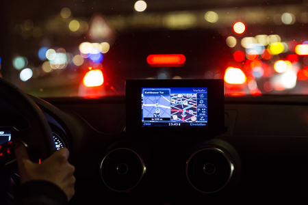 Satelite navigation device in a car at night