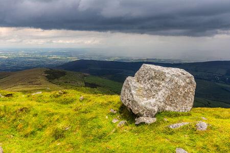 blackrock: Bright lit rock on a mountain ridge