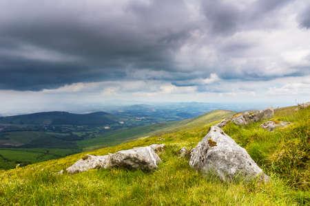 leinster: Brightly lit rocks on a hillside