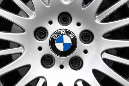 unique characteristics: NETHERLANDS - SEPTEMBER 22, 2014: Parked BMW with recognisalbe logo and characteristic alloy wheel.