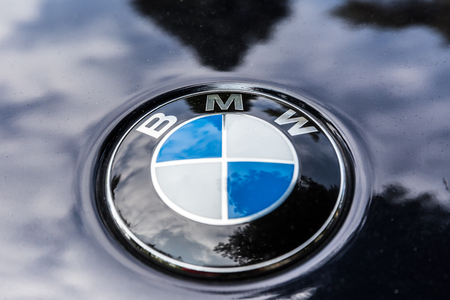 unique characteristics: NETHERLANDS - SEPTEMBER 22, 2014: Parked BMW with recognisable round logo Editorial