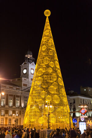 MADRID, SPAIN - DECEMBER 31, 2014: The famous Puerta del Sol with illuminated Christmas tree on December 31 in Madrid. Puerta del Sol traditionally is the centre of New Year celebrations each year in Madrid, the capital city of Spain. Editorial