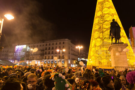 MADRID, SPAIN - DECEMBER 31, 2014: The famous Puerta del Sol crowded with tourists on December 31 in Madrid. Puerta del Sol traditionally is the centre of New Year celebrations each year in Madrid, the capital city of Spain.