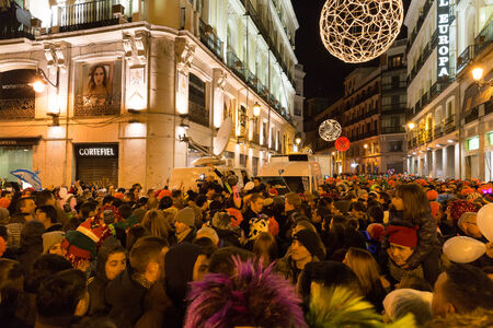 MADRID, SPAIN - DECEMBER 31, 2014: The famous Puerta del Sol crowded with tourists on December 31 in Madrid. A TV crew is filming the live event.