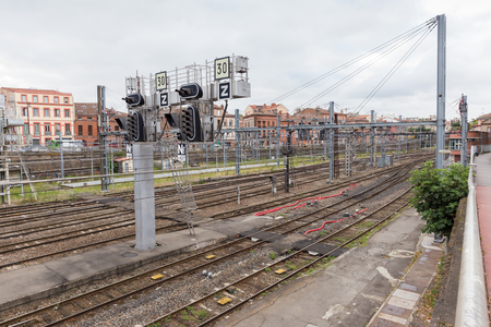 maintains: TOULOUSE, FRANCE - JULY 21, 2014: R�seau ferr� de France (RFF), owns and maintains the French national railway network. The lozenge indicates that the signal is equipped with an in-cab repeater.