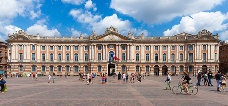 locals: TOULOUSE, FRANCE - JULY 21, 2014: Tourists and locals pay a visit to the Capitole de Toulouse. The Capitole the Toulouse was built in 1190.