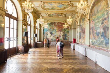 grandeur: TOULOUSE, FRANCE - JULY 21, 2014: The Salle Gervais in the Capitole de Toulouse. The Gervais room is decorated with murals, from left to right, love at 60, 40 and 20 years and Lile le de Cythere in the back.