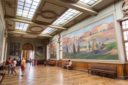renowned: TOULOUSE - JULY 21, 2014: Salle Henri Martin in the Capitole de Toulose is decorated with ten giant canvases by Henri Martin. Henri-Jean Guillaume Martin was a renowned French impressionist painter.