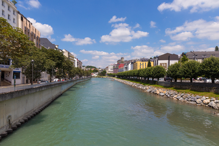 gave: LOURDES, FRANCE - JULY 23, 2014: The Gave de Pau river in Lourdes. It is a river in south-western France and a left tributary of the Adour. It takes its name from the city Pau, through which it flows. Editorial