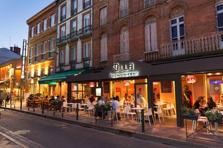 hugo: TOULOUSE, FRANCE - JULY 22, 2014: Victor Hugo in Toulouse refers to a neighborhood located in the city centre. Several restaurants are located at the square. Victor Hugo was a French poet and writer. Editorial