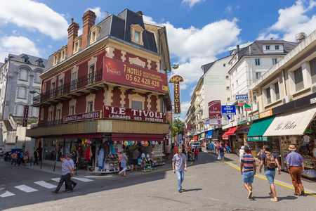 market place: LOURDES, FRANCE - JULY 23, 2014: Shoppers and tourists wander the town centre in Lourdes, France, looking for souvenirs and relics. Editorial