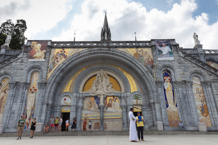 catholic priest: LOURDES - JULY 23, 2014: Notre Dame du Rosaire de Lourdes or the Basilica of our Lady of the Rosary is a Roman Catholic church and minor basilica within the Sanctuary of Our Lady of Lourdes in France.