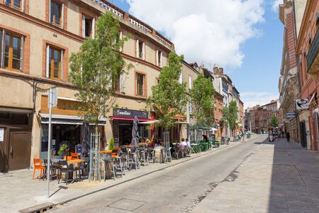 french doors: TOULOUSE, FRANCE - JULY 21, 2014: Rue Jean Suau is located in the heart of Toulouse, France. French restaurants tend to close up after lunch and open doors again for dinner. Editorial