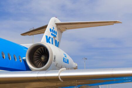 fuselage: AMSTERDAM - 19 JULY, 2014: The KLM Cityhopper Fokker 70 is powered by two Rolls-Royce Tay 620 turbofans placed at the back of the fuselage.