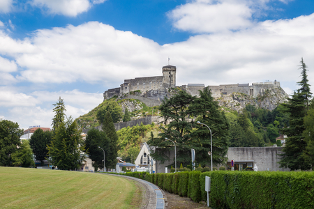 fastness: LOURDES, FRANCE - JULY 23, 2014: The chateau fort de Lourdes is a historic castle located in Lourdes in the Hautes-Pyrenees departement of France. Musee Pyreneen is located in the fort. Editorial
